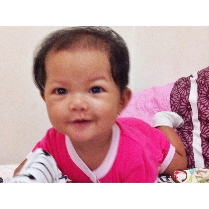 Masih kriyip-kriyip. Her first day at six months old :)